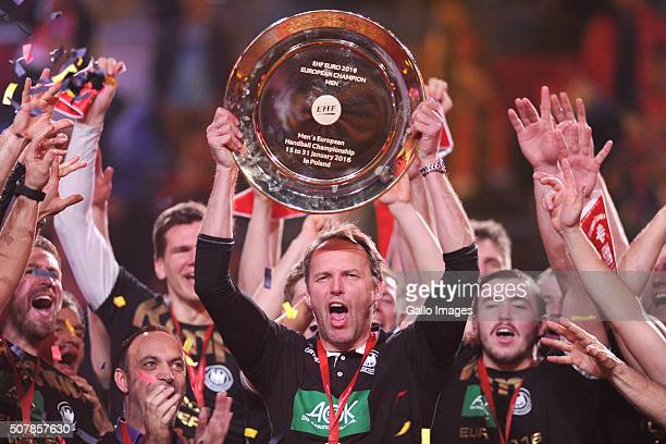 The German team celebrates victory in the finals of the EHF European Men's Handball Championships after the final between Spain and Germany at Tauron...