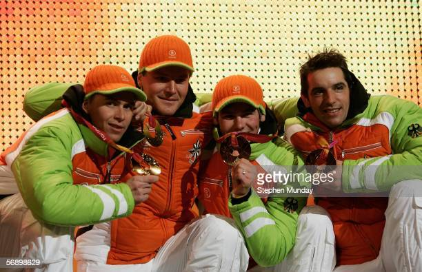 The German team of Ricco Gross Michael Roesch Sven Fischer and Michael Greis receive the Gold medal in the Mens Biathlon 4x75km Relay at the Medals...