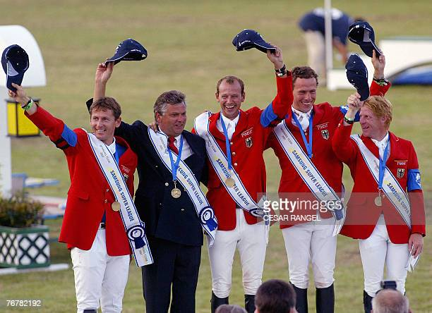 The German team of Thomas Muhlbauer Kurt Gravemier Marco Kutcher Chistian Ahlmann and Marcus Ehning pose with their sashes after winning the final of...