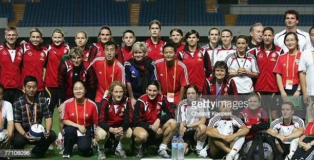 The German team poses with the volunteers after the Women's German National Team training session in the Pudong Yuanshen Stadium on September 29 2007...