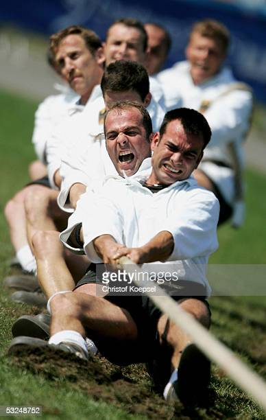 The German team pulls the rope against Sweden in the tug of war during the World Games 2005 on July 17 2005 in Duisburg Germany
