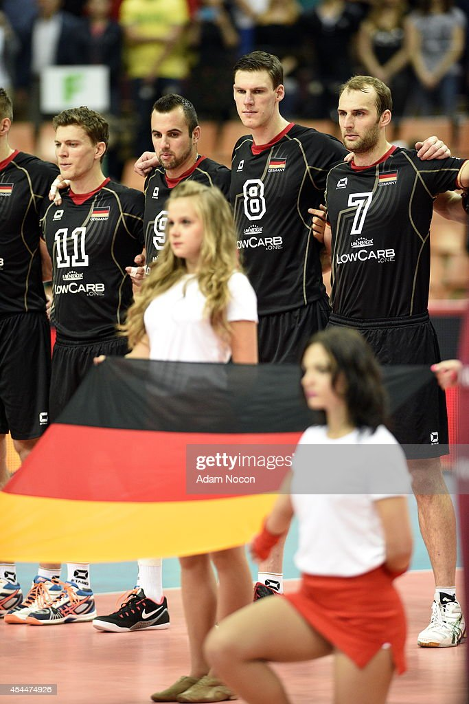The German team stands together during the national anthem at the FIVB World Championships match between Brazil and Germany on September 1, 2014 in Katowice, Poland.