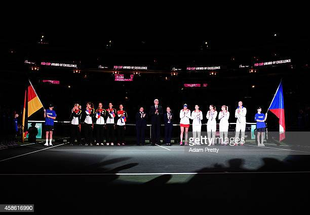 The Germany and the Czech Republic teams line up before the first rubber of the Fed Cup Final between Petra Kvitova of the Czech Republic and Andrea...
