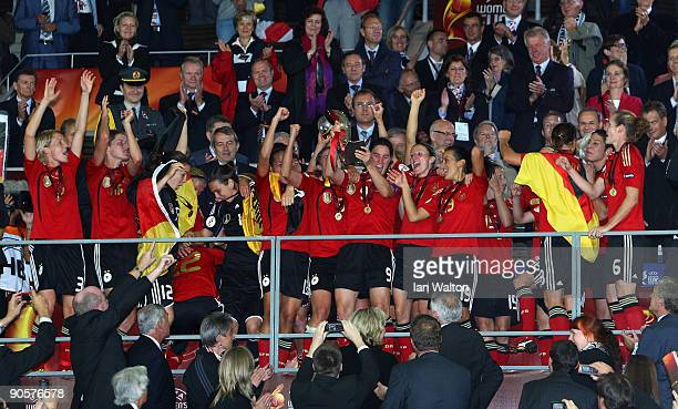 The Germany players celebrate with the trophy after winning the UEFA Women's Euro 2009 Final match between England and Germany at the Helsinki...