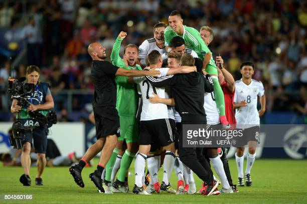 The Germany team celebrate victory after the UEFA European Under21 Championship Final between Germany and Spain at Krakow Stadium on June 30 2017 in...