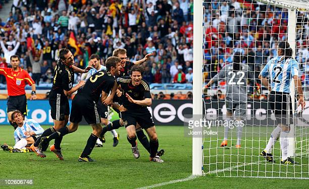 The Germany team celebrate with Arne Friedrich after he scores his team's third goal during the 2010 FIFA World Cup South Africa Quarter Final match...