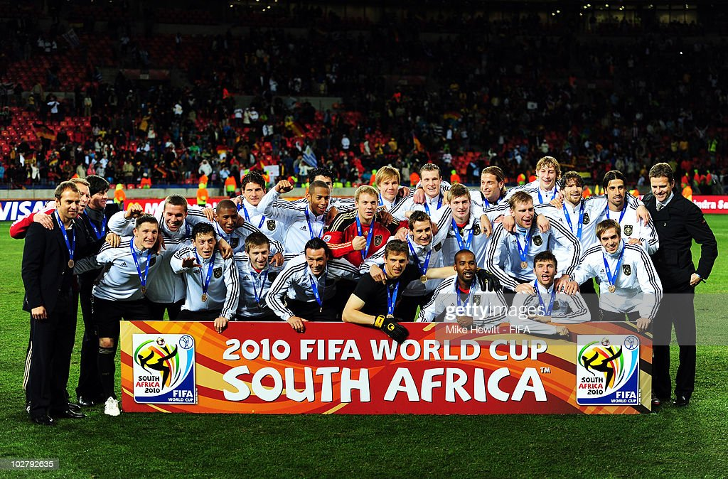 The Germany team celebrate with their bronze medals after coming third during the 2010 FIFA World Cup South Africa Third Place Play-off match between Uruguay and Germany at The Nelson Mandela Bay Stadium on July 10, 2010 in Port Elizabeth, South Africa.