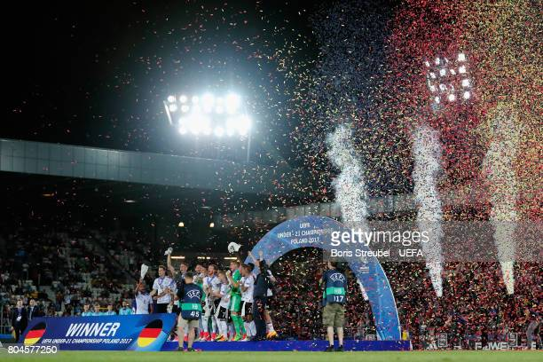 The Germany team lift the trophy after the UEFA European Under21 Championship Final between Germany and Spain at Krakow Stadium on June 30 2017 in...