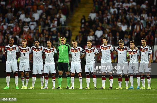 The Germany team stand for a minutes silence as they remember former DFB President Gerhard MayerVorfelder during the EURO 2016 Qualifier Group D...