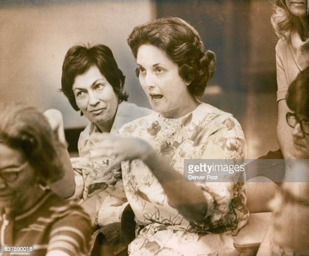 The gestures of active hands by Wheeling teacher Mrs Jane Frazier help emphasize special points of a question Mrs Jeannette Chidley background...