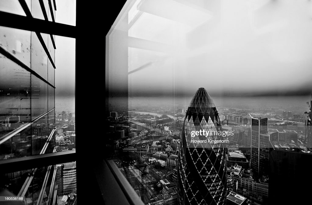 The Gherkin and the City looking East : Stock Photo