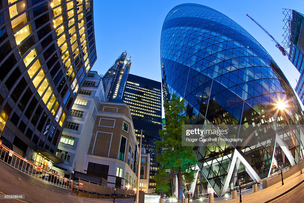 the gherkin building at night london uk stock photo