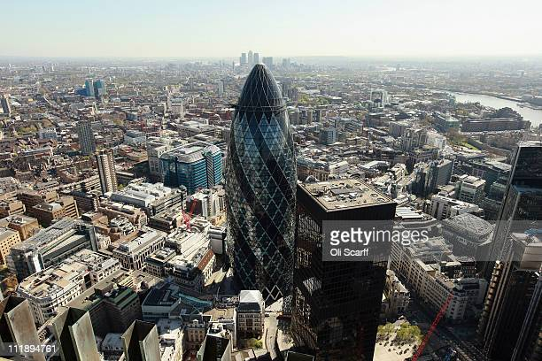 'The Gherkin' or 30 St Mary Axe stands near Tower 42 the City of London's tallest occupied building on April 8 2011 in London England The group led...