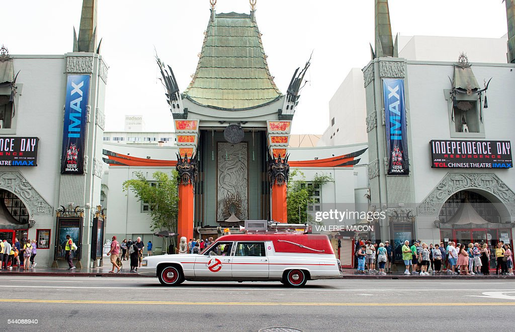 The Ghostbusters company car, Ecto1 is seen as it drives through the streets of Hollywood during Lyft Ghost Mode, In Partnership With Sony And 'Ghostbusters' in Hollywood, California, on July 1, 2016. The promotion for the new 'Ghostbusters' reboot offers customers the option to ride in Ghost Mode, an option in the Lyft app that will offer rides in Ecto-1 replica vehicles. / AFP / VALERIE