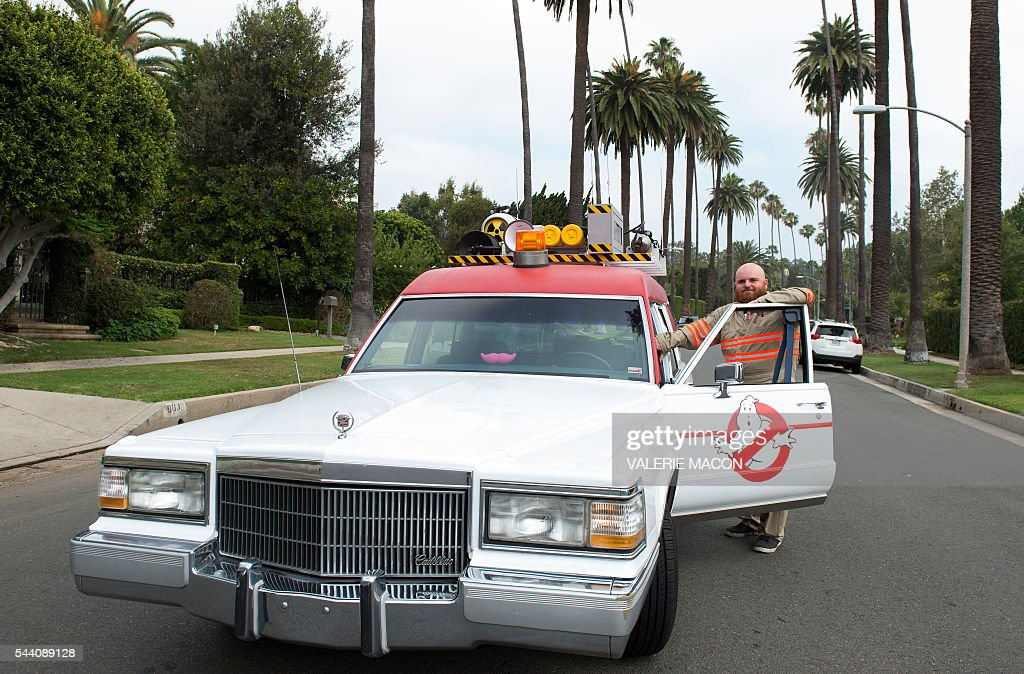The Ghostbusters company car, Ecto1 is seen as it drives through the streets of Beverly Hills during Lyft Ghost Mode, In Partnership With Sony And 'Ghostbusters' in Hollywood, California, on July 1, 2016. The promotion for the new 'Ghostbusters' reboot offers customers the option to ride in Ghost Mode, an option in the Lyft app that will offer rides in Ecto-1 replica vehicles. / AFP / VALERIE