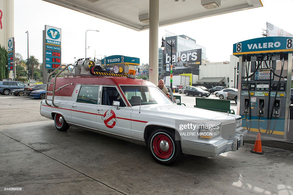 The Ghostbusters company car, Ecto1 is seen as it stops for gas during Lyft Ghost Mode, In Partnership With Sony And 'Ghostbusters' in Hollywood, California, on July 1, 2016. The promotion for the new 'Ghostbusters' reboot offers customers the option to ride in Ghost Mode, an option in the Lyft app that will offer rides in Ecto-1 replica vehicles. / AFP / VALERIE