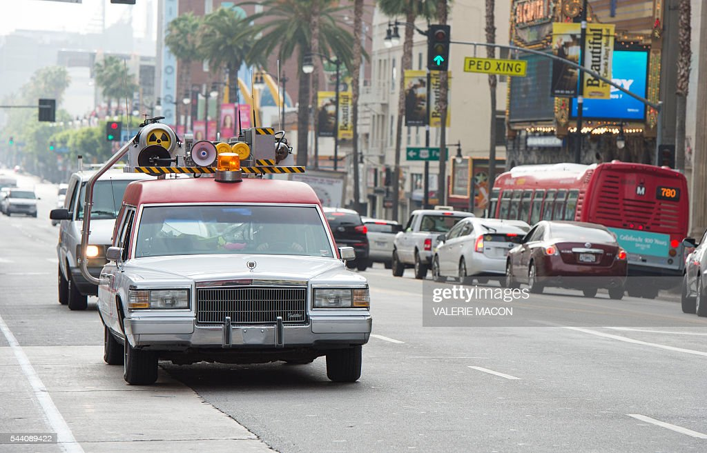 The Ghostbusters company car, Ecto1 is seen driving through Hollywood, during Lyft Ghost Mode, In Partnership With Sony And 'Ghostbusters' in Hollywood, California, on July 1, 2016. The promotion for the new 'Ghostbusters' reboot offers customers the option to ride in Ghost Mode, an option in the Lyft app that will offer rides in Ecto-1 replica vehicles. / AFP / VALERIE