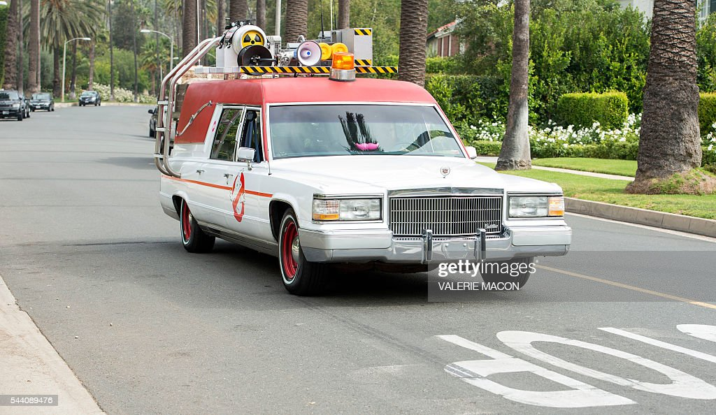 The Ghostbusters company car, Ecto1 is seen driving through the streets of Beverly Hills, during Lyft Ghost Mode, In Partnership With Sony And 'Ghostbusters' in Hollywood, California, on July 1, 2016. The promotion for the new 'Ghostbusters' reboot offers customers the option to ride in Ghost Mode, an option in the Lyft app that will offer rides in Ecto-1 replica vehicles. / AFP / VALERIE