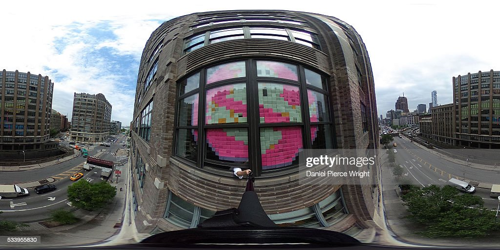 The Ghostbusters logo constructed out of Post It notes is shown on a Canal St. office window, across the street from a large 'mic drop' Post It creation May 24, 2016 in New York City. Two office buidling in lower Manhattan have been having a 'Post It War' with designs created from the sticky notes.