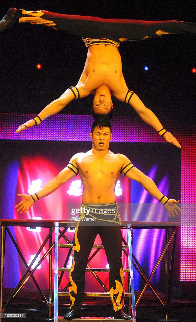 The Giang Quoc brothers of Vietnam perform at the UniverSoul Circus at Chene Park on September 7, 2013 in Detroit, Michigan.