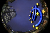 The giant Euro symbol stands outside the headquarters of the European Central Bank on January 8 2013 in Frankfurt am Main Germany The governing board...