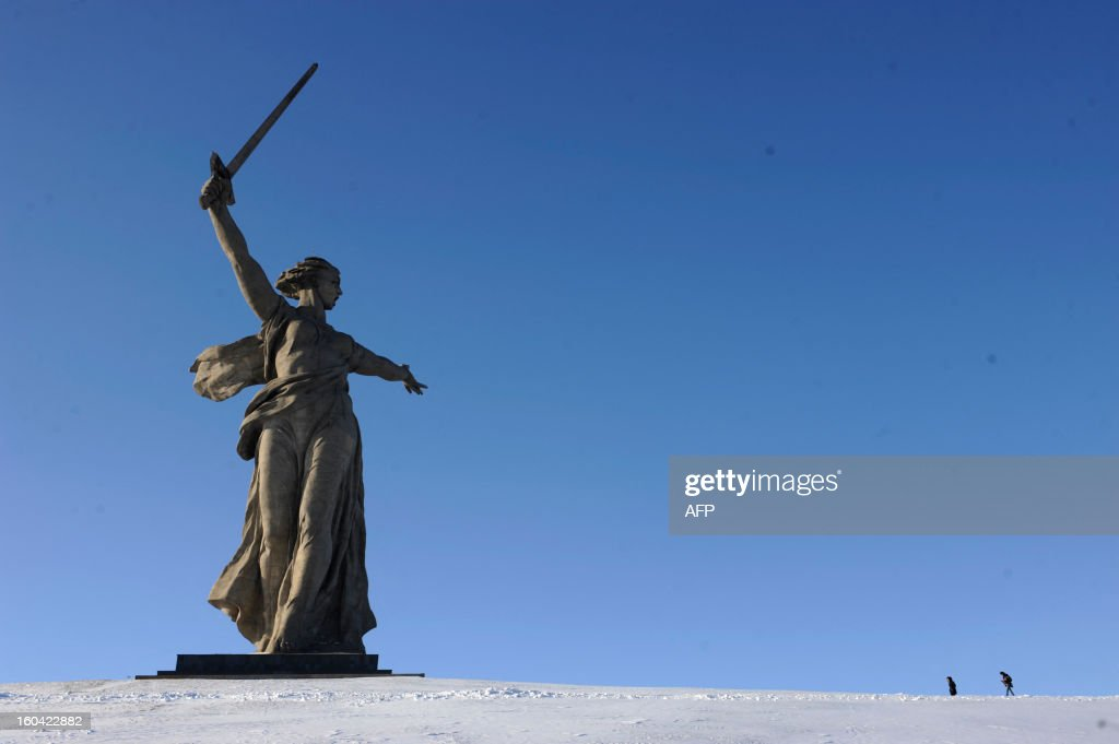 The giant monument 'Rodina-Mat' zovyot!''( Mother Motherland Is Calling for Fight) also known as Mother Motherland statue, rises at the memorial on Mamayev Hill built to honour those who died in the Battle of Stalingrad during the World War II, in the Russian city of Volgograd, formerly Stalingrad, on January 31, 2013. In a new display of national pride and reminder of its status as a world power, Russia remembers this weekend the Red Army victory in the battle of Stalingrad over invading Nazi forces, one of the bloodiest battles in human history. AFP PHOTO / MIKHAIL MORDASOV