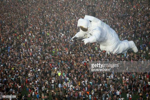The giant moving inflated astronaut art piece Escape Velocity is surrounded by music fans at the Coachella Valley Music Arts Festival at the Empire...