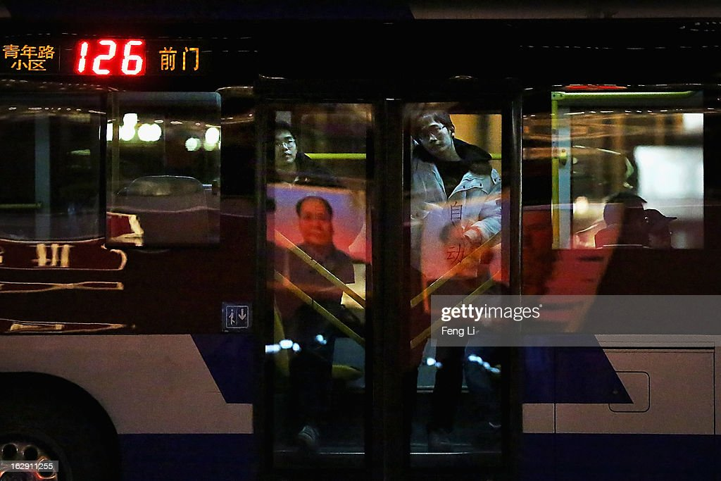 The giant portrait of the late chairman Mao Zedong reflects on the glass door of a bus in front of the Tiananmen Gate on March 1, 2013 in Beijing, China. The reshuffle will be completed at the first annual session of the 12th National People's Congress (NPC), which is scheduled to begin on March 5, and the first annual session of the 12th National Committee of the Chinese People's Political Consultative Conference (CPPCC), which will commence on March 3.