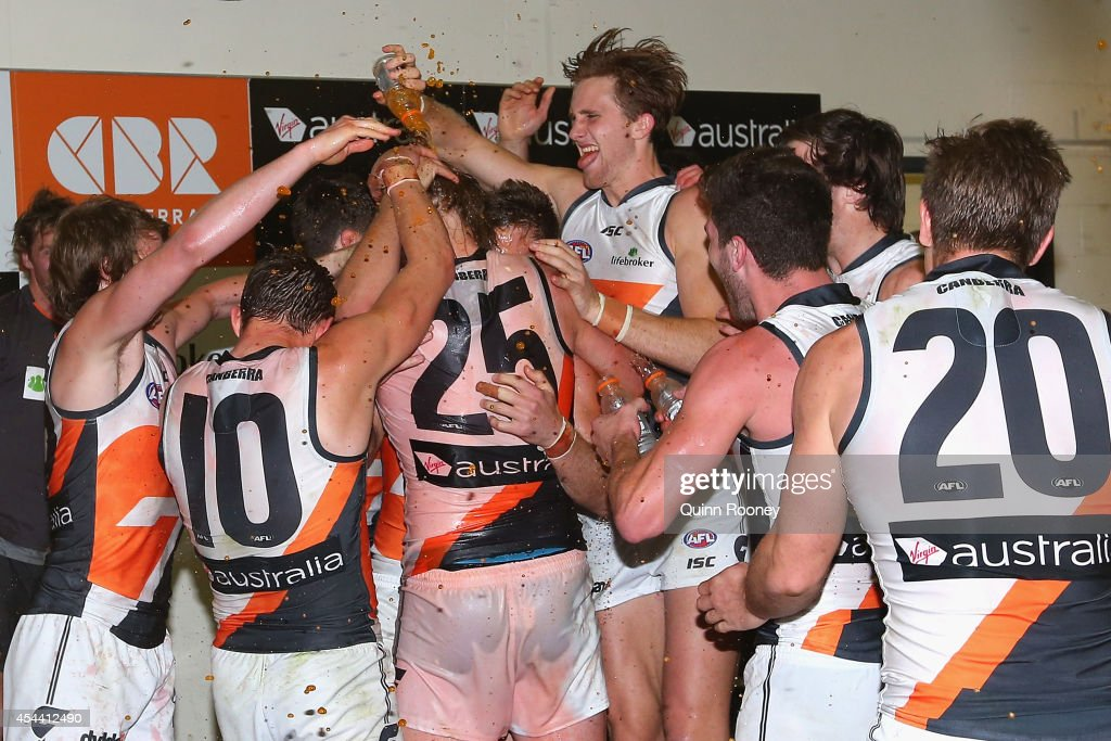 The Giants celebrate in the rooms after winning the round 23 AFL match between the Western Bulldogs and the Greater Western Sydney Giants at Etihad...