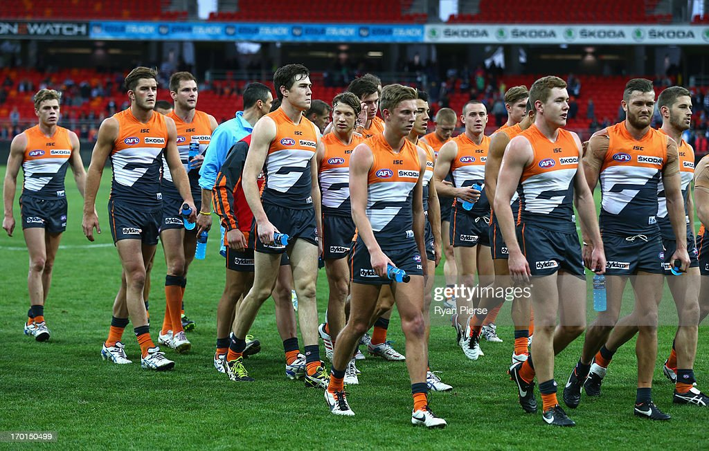 The Giants leave the ground after the round 11 AFL match between the Greater Western Sydney Giants and the Geelong Cats at Skoda Stadium on June 8, 2013 in Sydney, Australia.