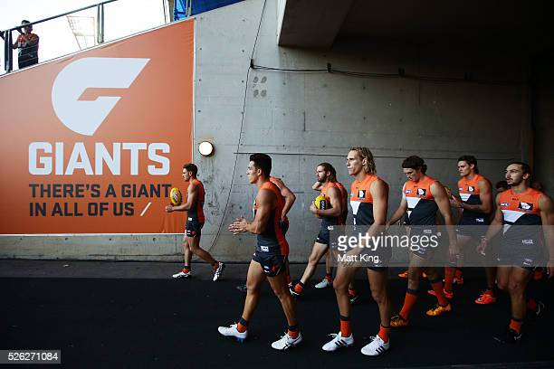 The Giants take the field during the round six AFL match between the Greater Western Sydney Giants and the Hawthorn Hawks at Spotless Stadium on...