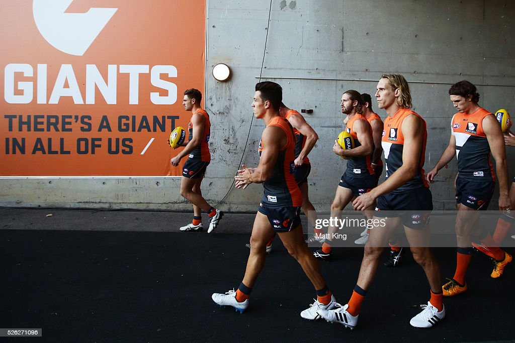 The Giants take the field during the round six AFL match between the Greater Western Sydney Giants and the Hawthorn Hawks at Spotless Stadium on April 30, 2016 in Sydney, Australia.