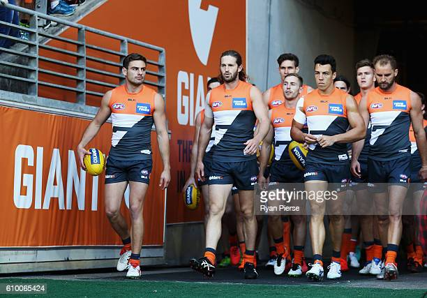 The Giants walk out onto the ground during the AFL First Preliminary Final match between the Greater Western Sydney Giants and the Western Bulldogs...