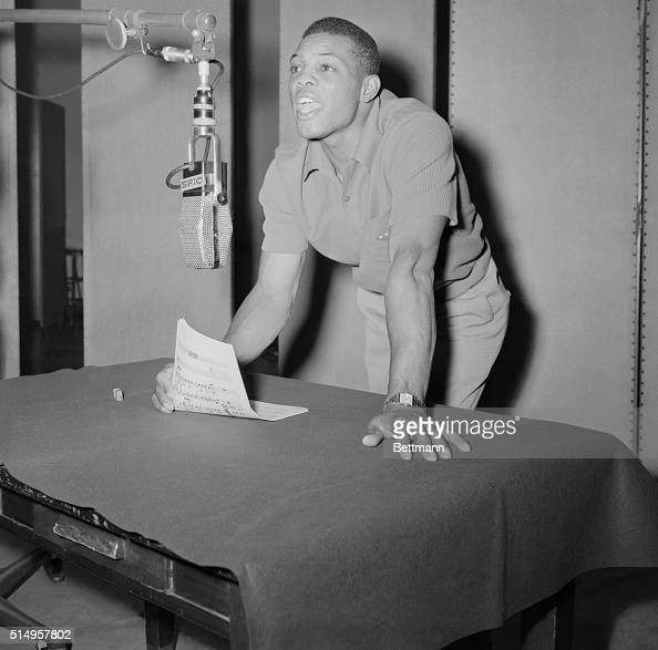 The Giant's Willie Mays who has been making himself heard around the National League with his big bat tries his hand in the musical entertainment...