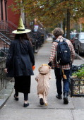 The Gibbs family of Clinton Hill Brooklyn make their way through the streets to 'trick or treat' as Brooklyn residents participate in Halloween...