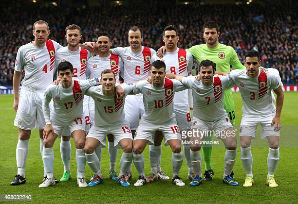 The Gibraltar team pose for a photograph prior to the EURO 2016 Qualifier match between Scotland and Gibraltar at Hampden Park on March 29 2015 in...