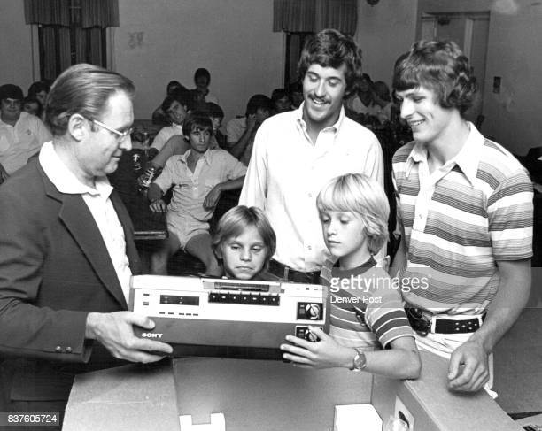 The Gift Speaks for Itself Evans Scholars a University of Colorado fraternity for Evans Scholarship recipients donate videotape machine to Boys Club...