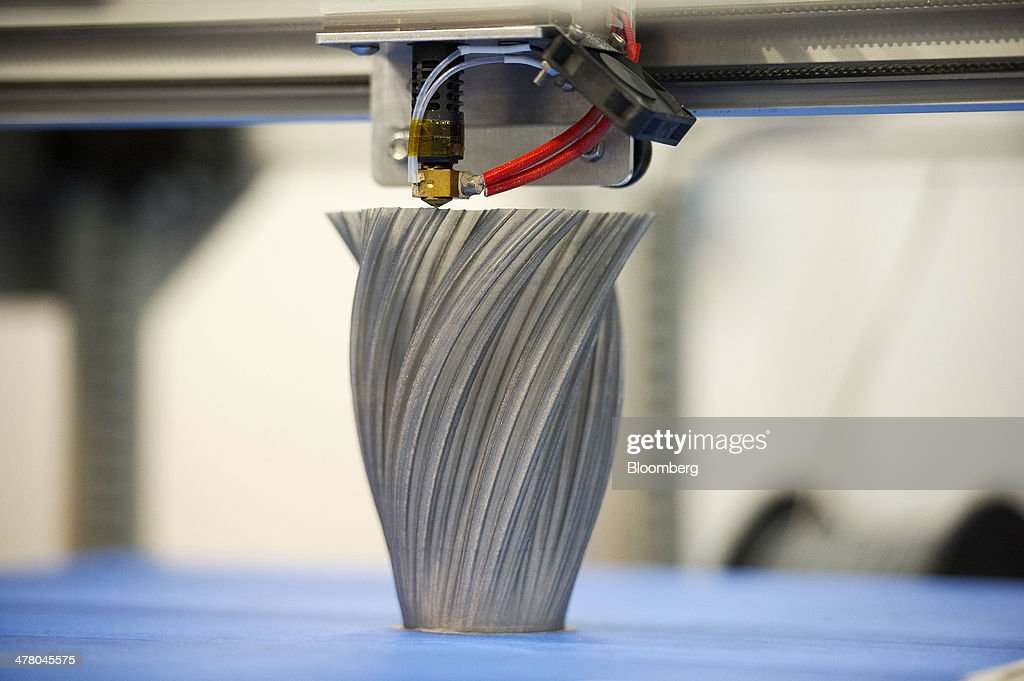 The Gigabot 3-D printer manufactured by re:3D Inc. makes a vase at the South By Southwest (SXSW) Interactive Festival in Austin, Texas, U.S., on Tuesday, March 11, 2014. The SXSW conferences and festivals converge original music, independent films, and emerging technologies while fostering creative and professional growth. Photographer: David Paul Morris/Bloomberg via Getty Images