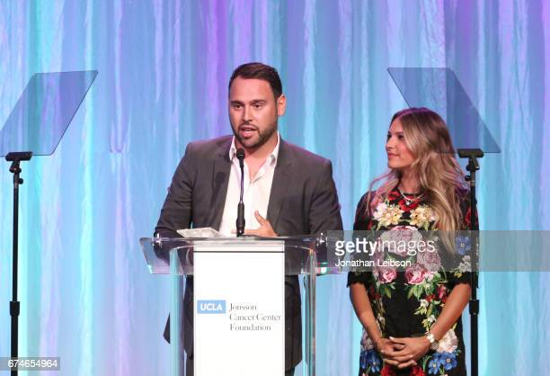 The Gil Nickel Humanitarian Award recipients Scooter and Yael Braun speak onstage at the UCLA Jonsson Cancer Center Foundation Hosts 22nd Annual...