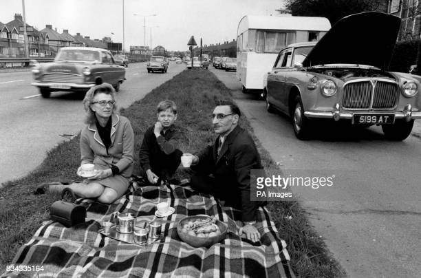 The Gilbert Family enjoy a picnic after they have been forced to spend the last five days of their holiday on the Kingston bypass after the clutch...