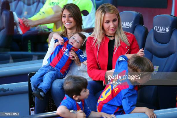 The gilrl friend of Leo Messi Antonella Roccuzzo and the wife of Luis Suarez Sofia Balbi with his children during the match between FC Barcelona and...