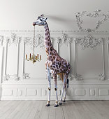 the giraffe hold the chandelier in the luxury decorated interior