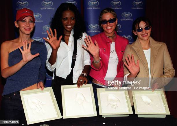The girl band All Saints Natalie Appleton Shaznay Lewis Nicole Appleton and Melanie Blatt had their hands cast for the 'Wall of Hands' at Madame...