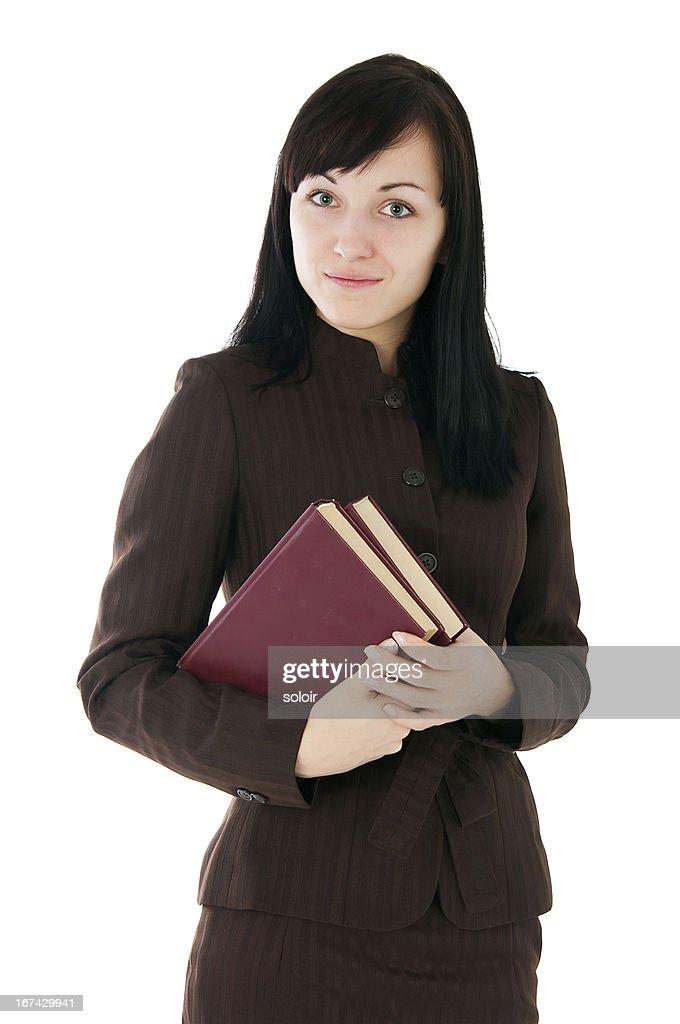 La chica en un traje de negocios con libros : Foto de stock