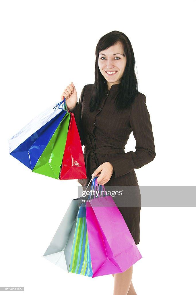 La chica en un traje de negocios con las compras : Foto de stock