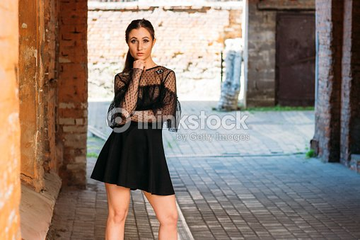 c6d27634d71 The girl is posing. Emotional portrait of Fashion stylish portrait of pretty  young woman. city portrait. sad girl. brunette in a black dress.  expectation. ...