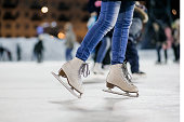 Girl on the figured skates at opened skating rink. Russia.