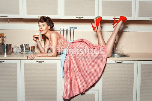The girl on the kitchen table stock photo thinkstock the girl on the kitchen table stock photo workwithnaturefo