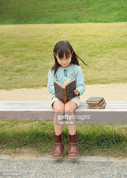 The girl reading a book,smile