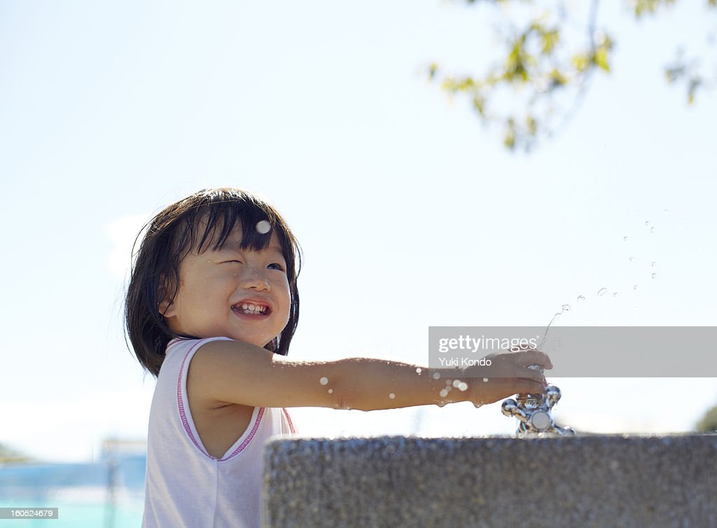 The girl who does water play. : Stock Photo